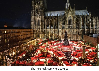 The famous german Cologne Cathedral Christmas Market with Illumination, Christmas Tree and Cathedral in the background.