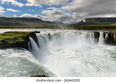 Famous Godafoss waterfall on a cloudy sunny day, view from above, North Iceland