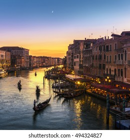 Famous Grand Canal view from Rialto Bridge at sunset, Venice, Italy