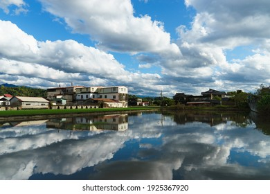 A famous Hakka country in Taiwan, Kaohsiung called Mino. The house, mountain and green field reflect on the water. Admire  nature of the entire town of Mino.