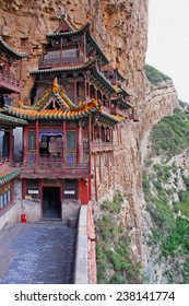 Famous hanging monastery in Shanxi Province near Datong, China, viewed from the side,  stylized and filtered to resemble an oil painting