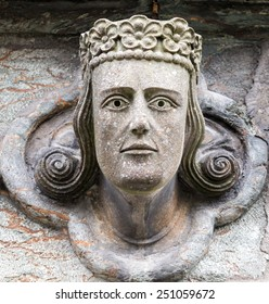 Famous head sculptures of kings, queens and bishops at the front of medieval Stavanger cathedral - or domkirke - in Norway