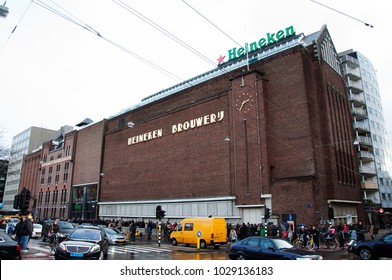 The famous Heineken brewery. Historic brewery. The exterior of the old brick building and the factory name. Amsterdam. Netherlands. December 2017.