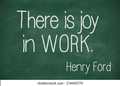 """famous Henry Ford quote """"There is joy in work."""" handwritten on blackboard"""