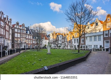 Famous historic Begijnhof (Beguinage, 1346) is one of the oldest inner courts in the city of Amsterdam. Begijnhof was founded during the middle Ages. Amsterdam, Netherlands.