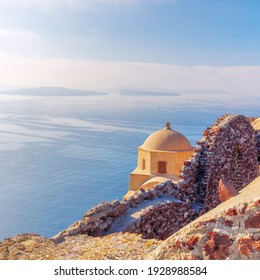 Famous historic chapel in the ruins of the castle, Santorini, Oia, Greece. Minimalistic composition with space for text