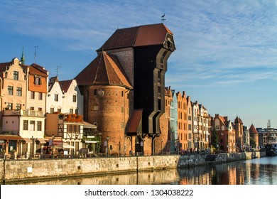 Famous historic Medieval port Crane (Żuraw / Krantor) - one of the Gdańsk water gates. Sunny morning on the Motlava River. Old town Gdansk (Gdańsk / Danzig), Poland (Polska / Polen).