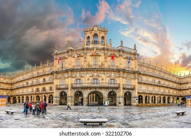 Famous and historic  Plaza Mayor in Salamanca at sunset with dramatic clouds, Castilla y Leon, Spain