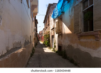 Famous historical narrow street and stone homes in Ayvalik, Balikesir.