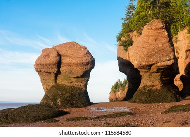Famous Hopewell Rocks flowerpot formations at low tide. New Brunswick, Canada. Taken soon after the sun has just risen.