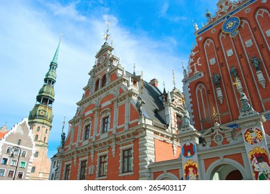 Famous House of Blackheads on the Town Square in Riga with a Church of St. Peter in the background