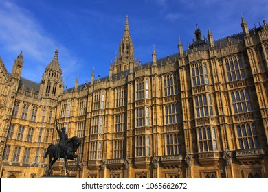 famous Houses of Parliament and statue of King Richard the Lionheart, in the Westminster Borough - sunny day with lots of architectural details. London, England