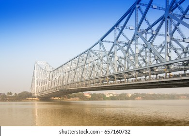 Famous Howrah Bridge connecting Howrah and Kolkata,a propped cantilever bridge with a suspended span over the Hooghly River in West Bengal, India.Commissioned in 1943.Transportation symbol of Kolkata.