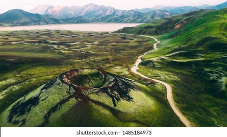 Famous Icelandic landmark in highlands, volcano red crater Stutur in Landmannalaugar area Iceland, green lava fields and mountains on the background, aerial view