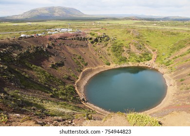 Famous icelandic tourist destination - volcanic crater lake of Kerid. Summer day.