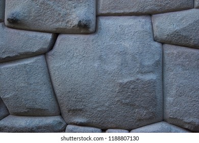 Famous Inca angled stone in Hatun Rumiyoc wall, an archeological artefact in Cuzco, Peru. It was part of a stone wall of an Inca palace, and is considered to be a national heritage object Cusco