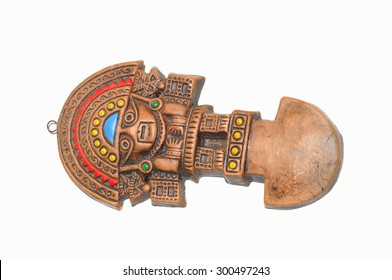 The famous Inca Tumi, an Incan statue made of either bronze, copper, gold-alloy, wood, or silver alloy. It is a sacrificial ceremonial axe distinctly characterized by a semi-circular blade on white