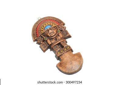 The famous Inca Tumi, made of either bronze, copper, gold-alloy, wood, or silver alloy. It is a sacrificial ceremonial axe distinctly characterized by a semi-circular blade on white. Selective focus