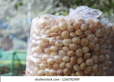 Famous Indian street snack 'Fuchka' or 'Golgappa' or 'Panipuri' at display inside a polybag.