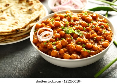 Famous Indian vegan food - channa masala or chickpeas curry served on a rustic background,vegan dish concepts.
