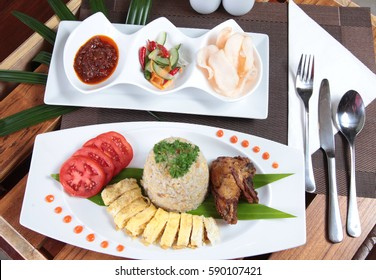 famous indonesian food fried rice with compltte condiment and chicken