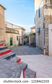 The famous intersection of Stolarska and Put Gradine streets with painted steps in Skradin town, Croatia