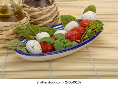 Famous italian caprese salad with fresh basil leaves