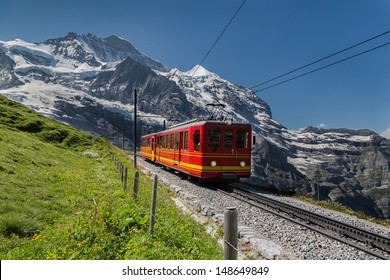 Famous Jungfrau Bahn with Beautiful Mountain View in Sunny Day