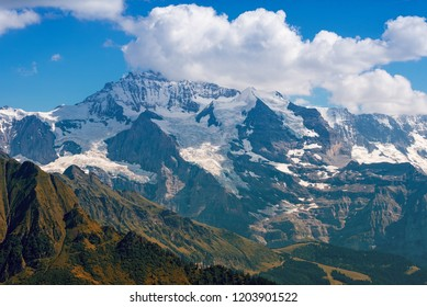 the famous Jungfrau mountain with glacier, clouds on the top, beautiful tourist destination switzerland, canton bern, bernese oberland