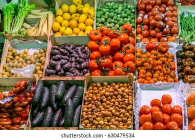 Famous La Boqueria market with vegetables and fruits in Barcelona, Spain