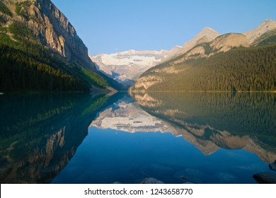Famous Lake Louise in Canada, perfect reflection of the moutains in the water for the sunrise