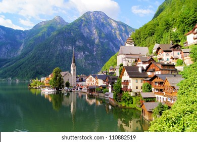 Famous lake side view of Hallstatt village with Alps behind, Austria