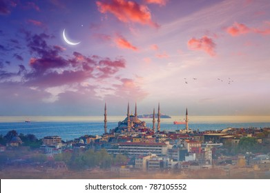 Famous landmark Blue Mosque, beautiful glowing sunset with crescent in Istanbul, Turkey. Elements of this image furnished by NASA