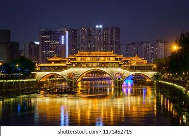 Famous landmark of Chengdu - Anshun bridge over Jin River illuminated at night, Chengdue, Sichuan , China