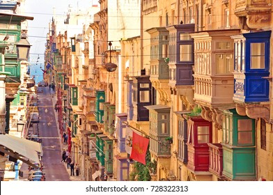 Famous landmark of hilly road with colourful balconies in the ancient city of Valletta, Malta