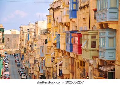 Famous landmark of hilly street with colourful balconies in the ancient city of Valletta, Malta