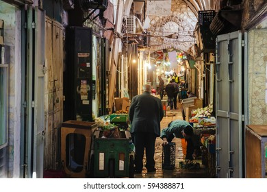 Famous landmark of Jerusalem - Market in Old city, The Muslim Quarter. Narrow street with ancient Jerusalem architecture, Israel. Narrow street in old city part of Jerusalem with famous bazaar, Israel
