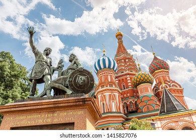 Famous landmark St Basil Cathedral with Minin and Pogarsky statue