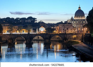 famous landmark st. peter basilica and sant'angelo bridge at the sunset reflection on tiber river rome italy