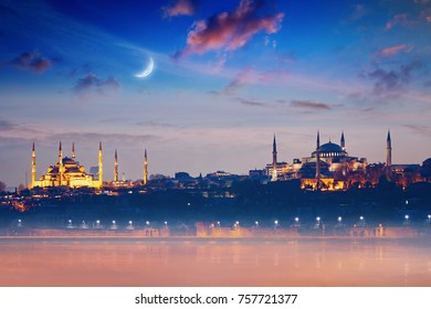 Famous landmarks Hagia Sophia and Blue Mosque, beautiful glowing sunset with crescent in Istanbul, Turkey. Elements of this image furnished by NASA.