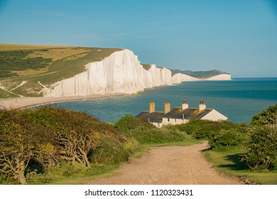 The famous landscape, Seven Sisters Cliffs with Coastguard Cottages at West Sussex, United Kingdom