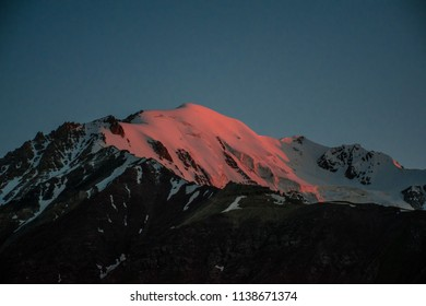 The famous Lenin peak with rocks and ice in Pamir mountains in Kyrgyzstan near Osh at sunset. Best place for active life, climbing and trekking. Best view from the tent. Open space for dreamers.