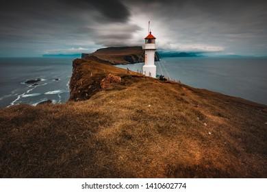 famous lighthouse on the island of Mykines, Faroe.