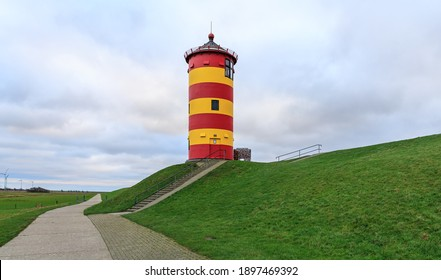 Famous lighthouse of Pilsum in Easter Frisia aka Ostfriesland at the North Sea coast