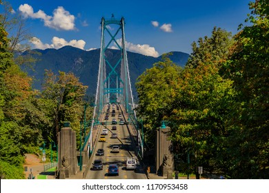 Famous Lions Gate Suspension Bridge or First Narrows Bridge in Stanley Park Vancouver, Canada with car traffic