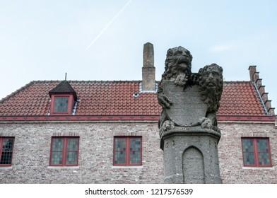 The famous lions of Huidenvettersplein square in Bruges, West Flanders, Belgium, Europe. Unesco heritage site. Flemish Symbols.