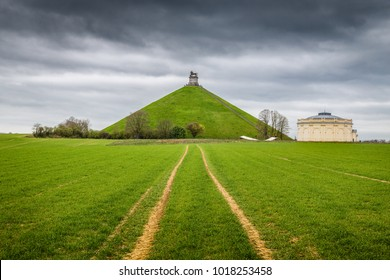 Famous Lion's Mound (Butte du Lion), a conical artificial hill located in the municipality of Braine-l'Alleud comemmorating the battle of Waterloo, on a moody day with dark clouds in summer, Belgium