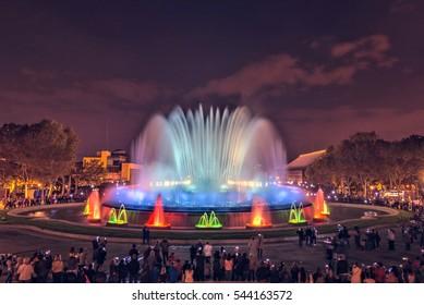 The famous Magic Fountain light show at night. Plaza Espanya in Barcelona, Spain