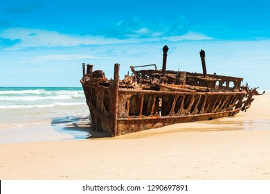 Famous Maheno Shipwreck on Fraser Island on a sunny summer day with blue sky and clouds without tourists / no people (Fraser Island, Australia)