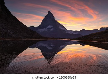 The famous Matterhorn reflected in the Riffelsee and during a colourful sunet in Switzerland.